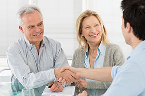 Man and Woman Consulting with Realtor